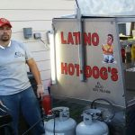 Julio Mireles by one of his food carts.